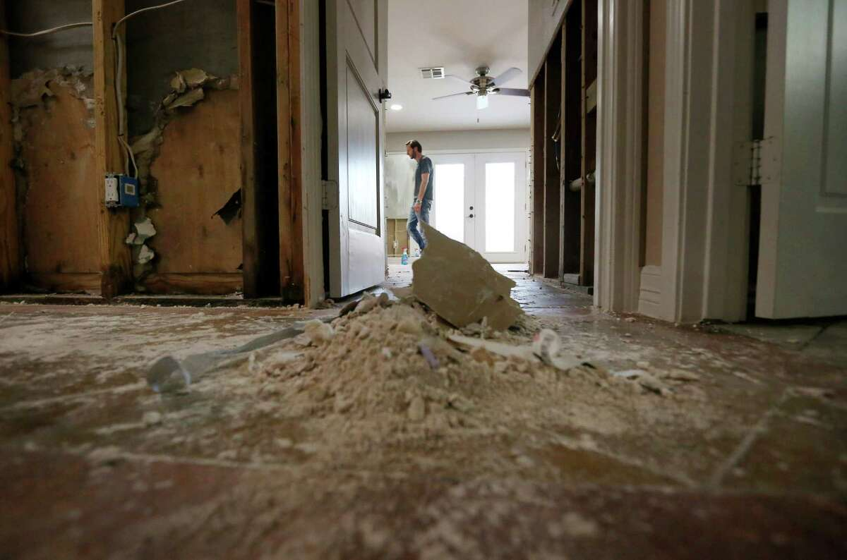 Tom Harari walks through his now empty master bedroom, in his Meyerland home, Wednesday, April 20, 2016, in Houston. Harari and his family have been through multiple floods, and he says they are afraid of losing the sense of community as neighbors decide to move away.