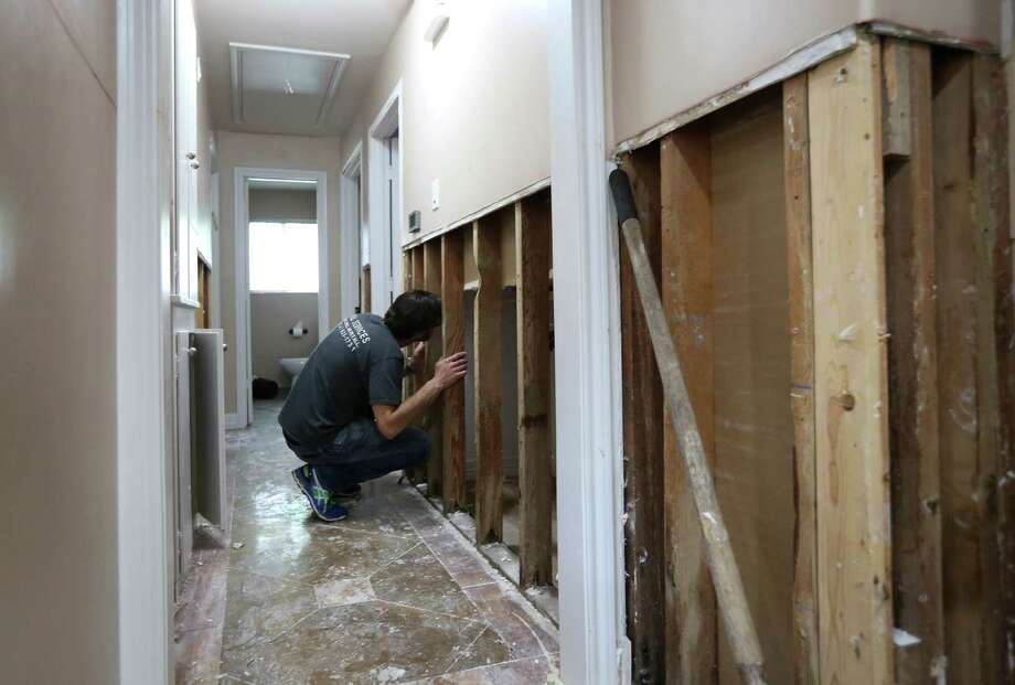 Tom Harari looks through the wall into one of the bedrooms in his Meyerland home, Wednesday, April 20, 2016, in Houston.  Harari and his family have been through multiple floods, and he says they are afraid of losing the sense of community as neighbors decide to move away. Photo: Jon Shapley, Houston Chronicle / © 2015  Houston Chronicle