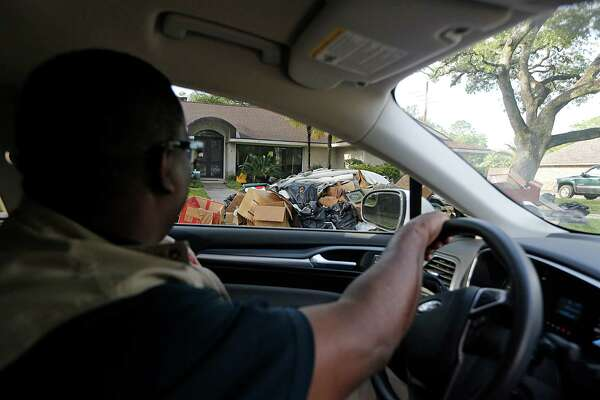 City of Houston Department of Neighborhoods Code Enforcement Officer Melvin Hopkins during a Windshield Survey For Damage Assessments of residential flooding in the Meyerland area Wednesday, April 20, 2016, in Houston.