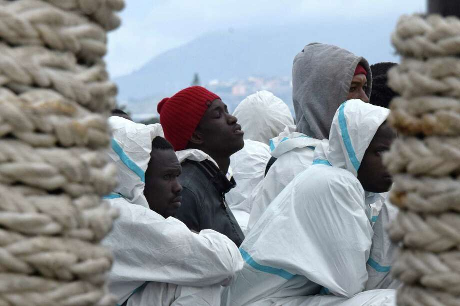 Men wait to disembark from the Italian Coast Guard vessel in February following a rescue at sea. A shipwreck last week may have claimed the lives of up to 500 people, survivors said. Photo: GIOVANNI ISOLINO, Stringer / AFP or licensors