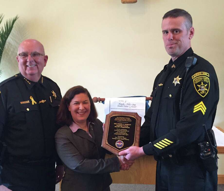 Saratoga County Sheriff Michael Zurlo joins Saratoga County District Attorney Karen Heggen as she presents the 2016 Public Service Award to Sgt. Daniel Morley. (Submitted photo)