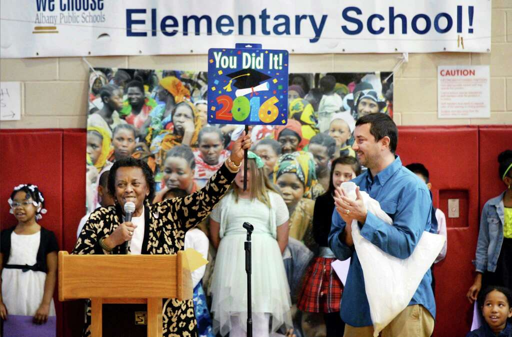Jean Dobbs of African Reflections Foundation and Kevin Bailey, right,owner of High Peaks Solar thank students at Pine Hills Elementary who raised $15,000 to support a deep water well in rural Tanzania during a ceremony at the school Wednesday April 20, 2016 in Albany, NY. (John Carl D'Annibale / Times Union) Photo: John Carl D'Annibale / 10036266A