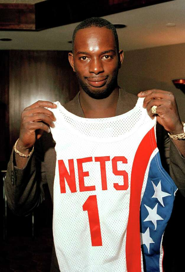 "FILE - In this Aug. 20, 1986 file photo, Dwayne ""Pearl"" Washington, the first draft pick by the New Jersey Nets, holds up his new uniform during a press luncheon at the Meadowlands Arena in East Rutherford, N.J.  Washington, who went from New York City playground wonder to Big East star for Jim Boeheim at Syracuse, has died. He was 52. Washington died Wednesday, April 20, 2015 of cancer, the university said.  (AP Photo/Ron Frehm, File) ORG XMIT: NY803 Photo: Ron Frehm / AP"