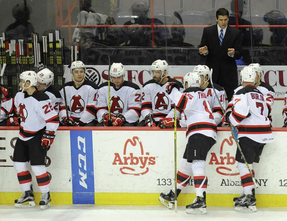 Albany Devils' head coach Rick Kowalsky instructs hius players against the   Providence Bruins' during the second period of an AHL hockey game in Albany, N.Y., Tuesday, Feb. 9, 2016. (Hans Pennink / Special to the Times Union) ORG XMIT: HP104 ORG XMIT: MER2016020920524747 Photo: Hans Pennink / Hans Pennink