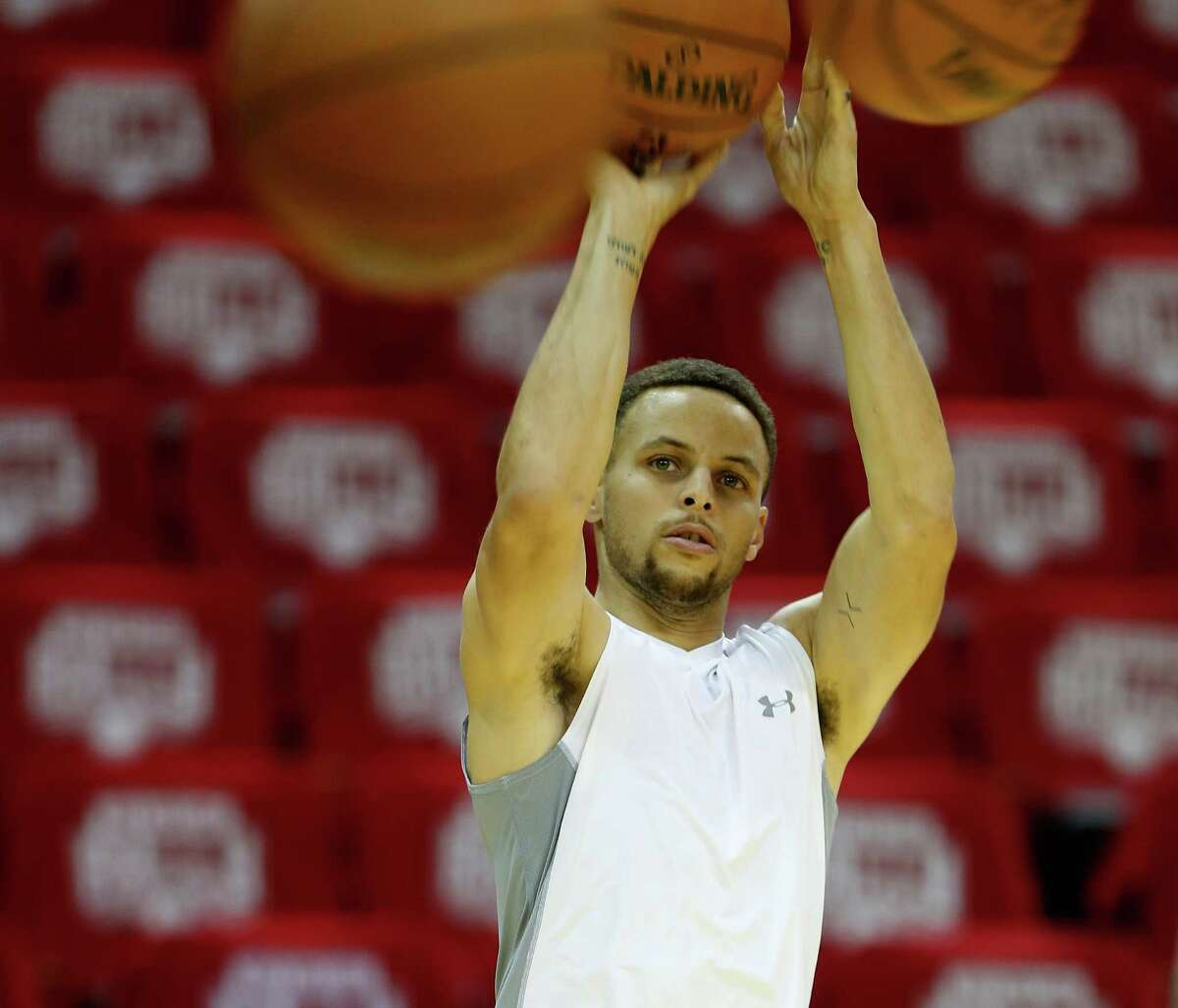 Golden State Warriors point guard Stephen Curry shoots baskets during team practice at Toyota Center, Wednesday, April 20, 2016, in Houston, as they prepared for Game 3 against the Houston Rockets in Round 1 of the playoffs.