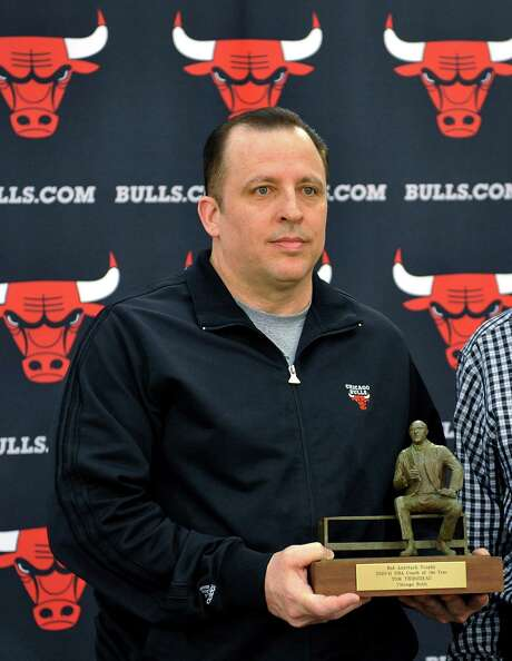 Chicago Bulls coach Tom Thibodeau holds he Red Auerbach Trophy after being named NBA basketball Coach of the Year, in Deerfield, Ill., Sunday, May 1, 2011. (AP Photo/David Banks) Photo: David Banks, FRE / FR165605 AP