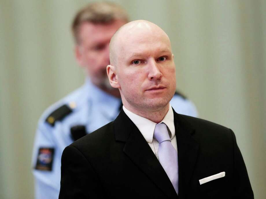 FILE - In this Friday, March 18, 2016 file photo, Anders Behring Breivik stands on the fourth and last day in court in Skien, Norway. The right-wing extremist was convicted of terrorism and mass murder for 2011 bomb and gun attacks in Norway that killed 77 people. (Lise Aserud/NTB Scanpix via AP, File)  NORWAY OUT Photo: Lise Aserud, SUB / NTB scanpix