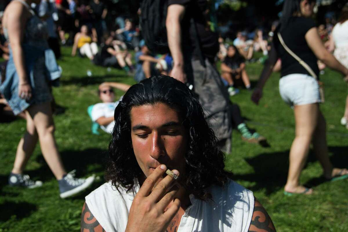 Dane Rocco enjoys a joint shortly before 4:20 p.m at 420 Vancouver at Sunset Beach in Vancouver, B.C. on Wednesday, April 20, 2016.
