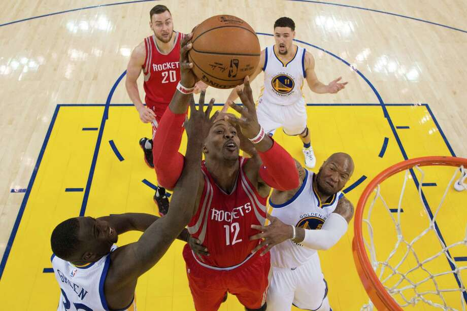 Golden State's Draymond Green, left, and Marreese Speights demonstrate to Dwight Howard (12) that the Warriors, who have won 13 of their last 14 meetings with the Rockets, are much more than a finesse team. Photo: Kyle Terada, Contract Photographer / Kyle Terada