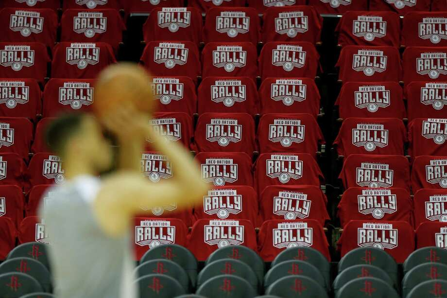 Warriors guard Stephen Curry does some shooting Wednesday at a Toyota Center adorned with T-shirts fans will be wearing Thursday night for Game 3, a contest Curry is questionable to take part in due to his ankle injury. Photo: Karen Warren, Staff / © 2016 Houston Chronicle