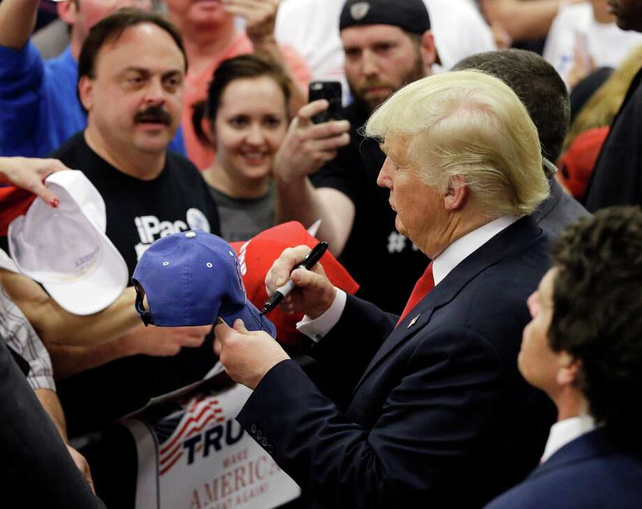 Republican presidential candidate Donald Trump signs autographs for supporters during a campaign stop Wednesday, April 20, 2016, in Indianapolis. (AP Photo/Darron Cummings) ORG XMIT: INDC121 Photo: Darron Cummings / Copyright 2016 The Associated Press. All rights reserved. This m