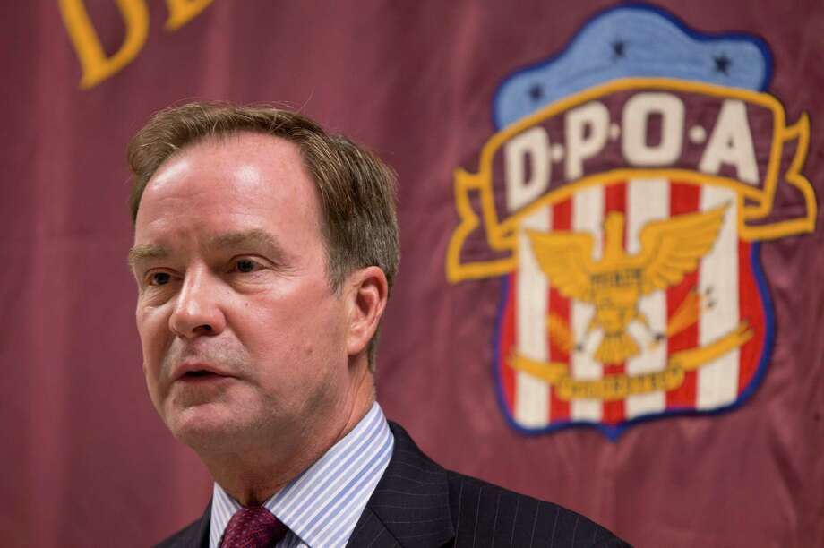 FILE - In this Sept. 10, 2014 file photo, Attorney General Bill Schuette speaks at the Detroit Police Officers Association in Detroit. Michigan's attorney general Schuette will announce criminal charges Wednesday, April 20, 2016, against two state regulators and a Flint employee, alleging wrongdoing related to the city's lead-tainted water crisis, according to government officials familiar with the investigation. (AP Photo/Paul Sancya, File) ORG XMIT: CAET940 Photo: Paul Sancya / AP
