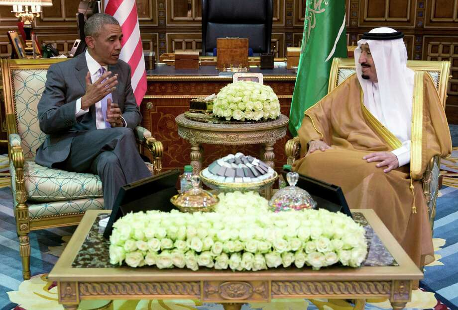 President Barack Obama and Saudi Arabia's King Salman meet at Erga Palace in Riyadh, Saudi Arabia, Wednesday, April 20, 2016. The president begins a six day trip to strategize with his counterparts in Saudi Arabia, England and Germany on a broad range of issues with efforts to rein in the Islamic State group being the common denominator in all three stops. (AP Photo/Carolyn Kaster) ORG XMIT: SAUK113 Photo: Carolyn Kaster / Copyright 2016 The Associated Press. All rights reserved. This m