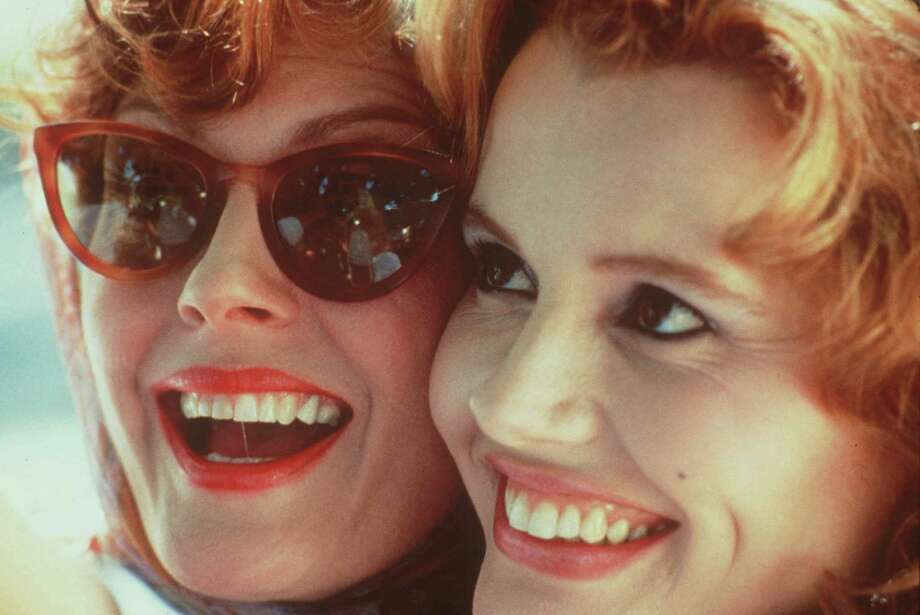 "Actresses Susan Sarandon, left, and Geena Davis pose in a scene for the 1991 film, ""Thelma & Louise."" Few previous movies had focused on females. / MGM"