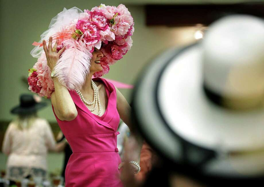 Jackie Kocher shows off her Fiesta Hat at the Fiesta Hat Contest & Luncheon organized by The Woman's Club of San Antonio on April 20, 2016. Photo: Bob Owen /San Antonio Express-News / San Antonio Express-News