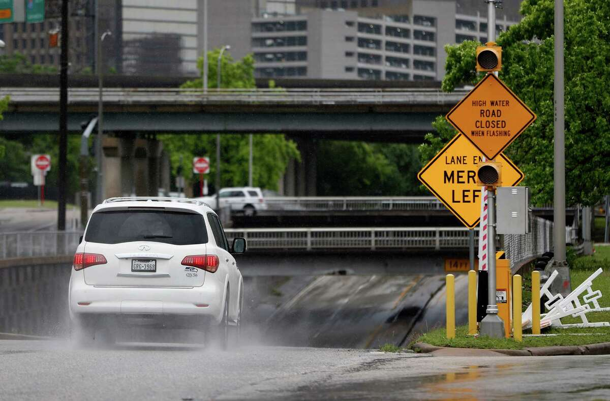 After last year's deadly Memorial Day floods, city officials identified 27 flood-prone locations where a gate, similar to one shown Wednesday at the Houston Avenue underpass at Memorial, will be installed.