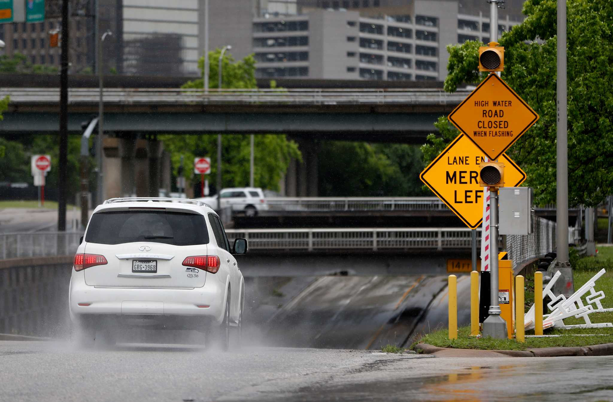 Officials Pledge Action After Flooded Roadway Deaths