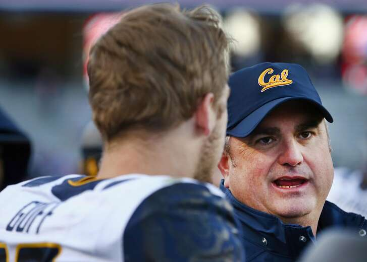 FORT WORTH, TX - DECEMBER 29:  Head coach Sonny Dykes of the California Golden Bears talks with Jared Goff #16 of the California Golden Bears in the fourth quarter of the Lockheed Martin Armed Forces Bowl at Amon G. Carter Stadium on December 29, 2015 in Fort Worth, Texas.  (Photo by Tom Pennington/Getty Images)