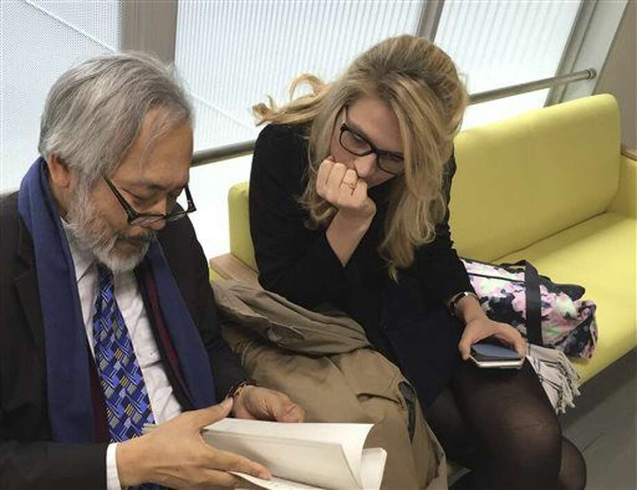 In this photo provided by Damien McKeon, Australian animal welfare activist Sarah Lucas talks with her lawyer Takashi Takano at Wakayama District Court in Wakayama, western Japan, Friday, March 25, 2016. The court ruled Friday that an aquarium had no right to bar Lucas, who wanted to check on a baby albino dolphin in captivity. The court awarded Lucas 110,000 yen ($970) in damages, a court official said, on customary condition of anonymity. Lucas, the head of Australia for Dolphins, called the verdict a victory in the fight to stop dolphin killings. She expressed concern for the albino dolphin, saying it was in a tiny crowded tank of chlorinated water, being bullied by other dolphins. (Damien McKeon via AP) Photo: Damien McKeon