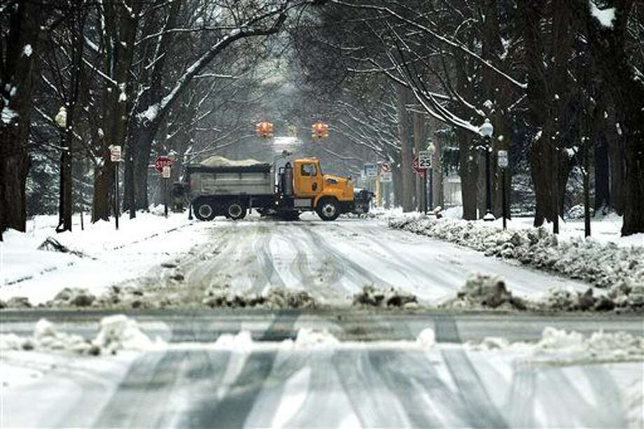 A plow clears streets in Traverse City, Mich, on Thursday, March 24, 2016, as a winter storm dumps snow and ice on the region. (Jan-Michael Stump/Traverse City Record-Eagle via AP) Photo: Jan-Michael Stump