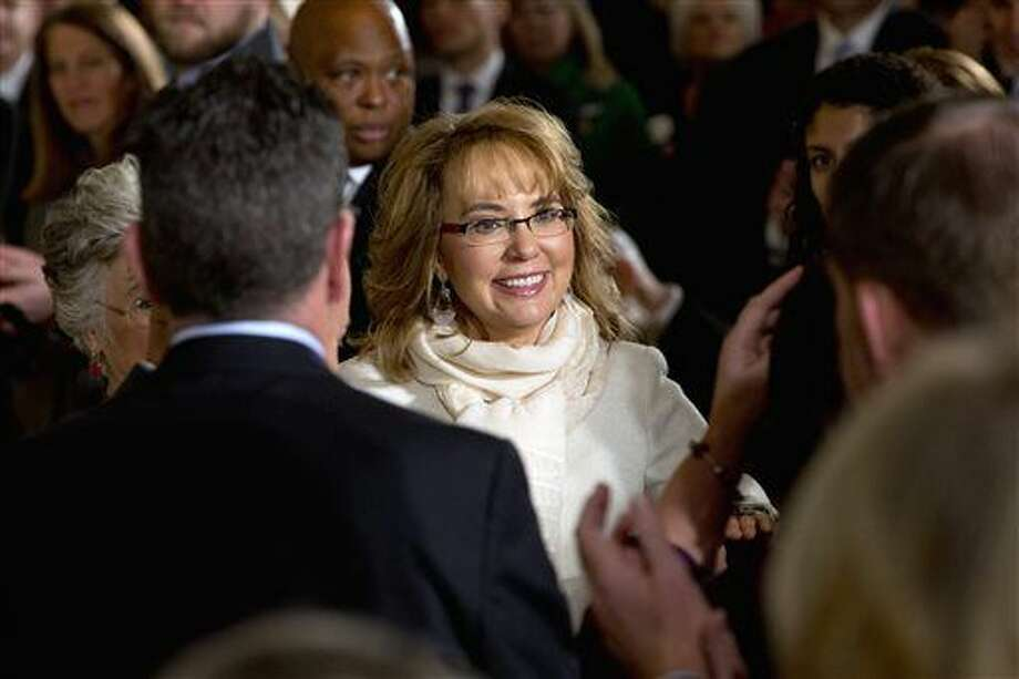 FILE - In this Jan. 5, 2016, file photo, people applaud former Arizona Rep. Gabby Giffords as she arrives in the East Room of the White House in Washington, to hear President Obama speak about steps his administration is taking to reduce gun violence. An official said Thursday, March 24, 2016, a lawsuit filed in the name of the man who shot former U.S. Congresswoman Giffords is bogus. Cosme Lopez with the U.S. Attorney's Office District of Arizona says attorneys for convicted killer Jared Lee Loughner notified the court that Loughner didn't file or authorize the lawsuit. (AP Photo/Jacquelyn Martin, File) Photo: Jacquelyn Martin