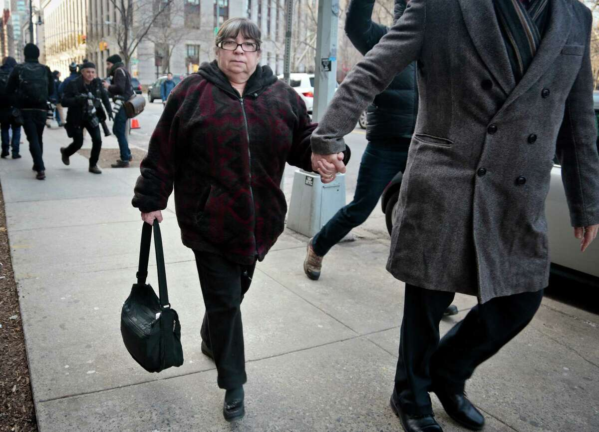 Annette Bongiorno, former secretary for imprisoned financier Bernard Madoff, is led from New York federal court in March 2014. Bongiorno is among five former employees of Madoff who were convicted of fraud.