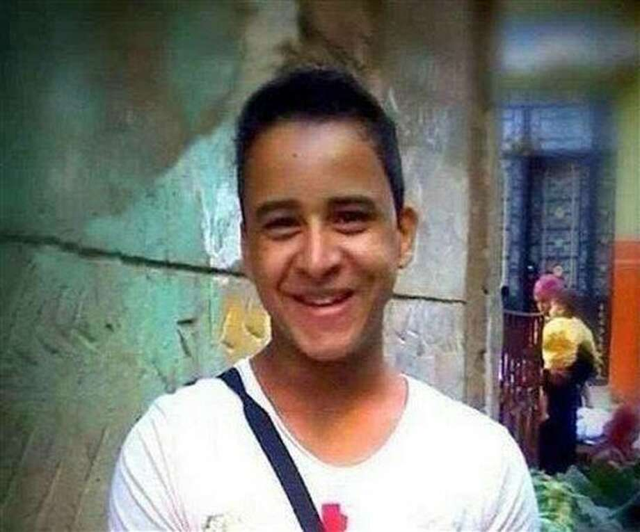 """This undated photo provided by the family of Mahmoud Mohammed Ahmed, shows Mahmoud Mohammed Ahmed in Cairo, Egypt prior to his arrest in Jan 2014 while wearing a T-shirt that bore the slogan """"A nation without torture."""" An Egyptian court on Thursday, March 24, 2016 ordered the release of Ahmed, who was accused by police of taking part in unauthorized demonstrations, possession of explosives and paying money to others to take part in street protests, his brother and lawyer told The Associated Press. He was never formally charged during his two years in detention. (Family of Mahmoud Mohammed Ahmed via AP) Photo: Uncredited"""