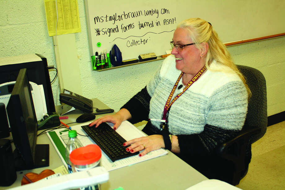 Pat Hagedon runs a tutoring program after school at Harbor Beach. She can have between 20 and 30 students in her tutoring session on any given night.