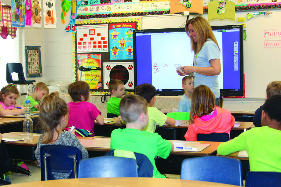 Ubly first grade teacher Amy Rothe talks to students during a spelling lesson prior to a big test the next day.