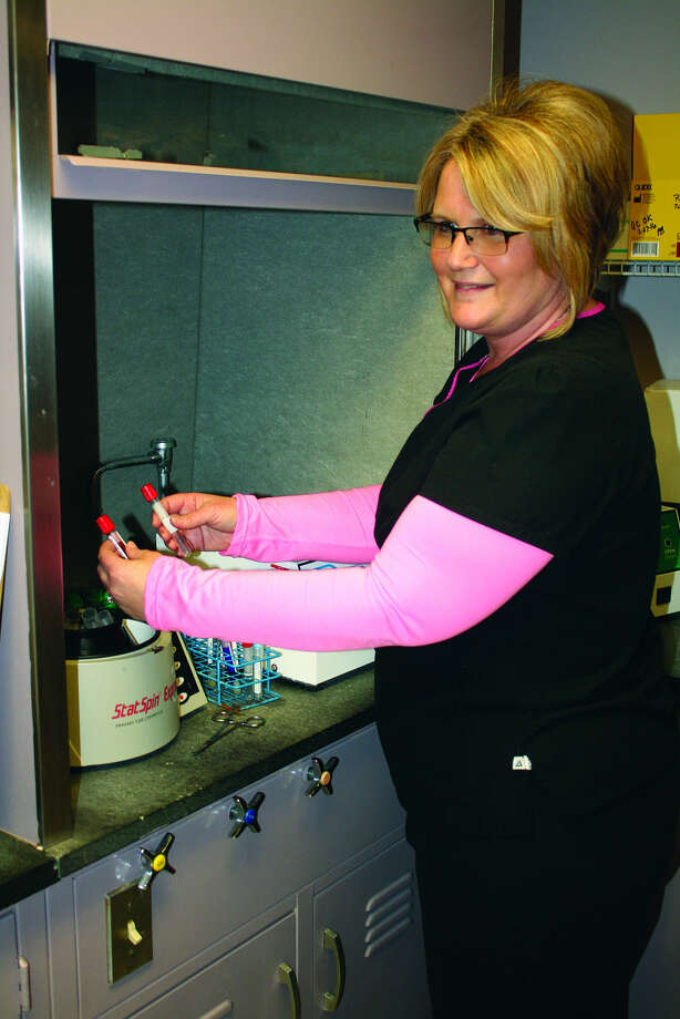 Joyce Susalla, a phlebotomist, works in the lab at Deckerville Community Hospital.