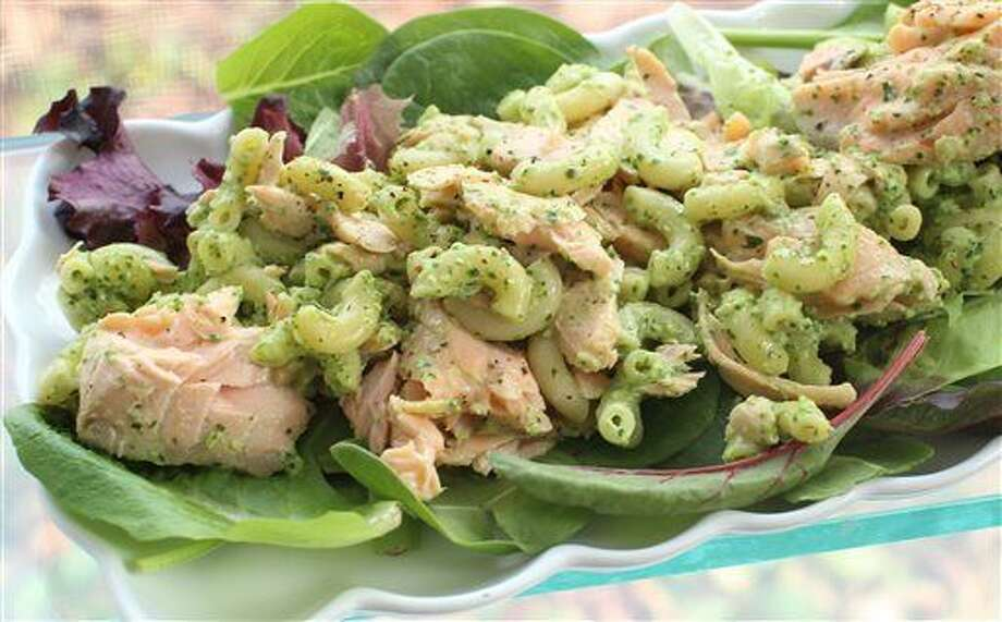 This Feb. 1, 2016 photo shows pasta salad with salmon and creamy cilantro dressing in Concord, N.H. This delicious spring dish is easy to assemble and travels well, making it perfect for packed lunches and picnics. It also can be prepped in advance by poaching the fish and cooking the pasta the night before. (AP Photos/Matthew Mead) Photo: Matthew Mead