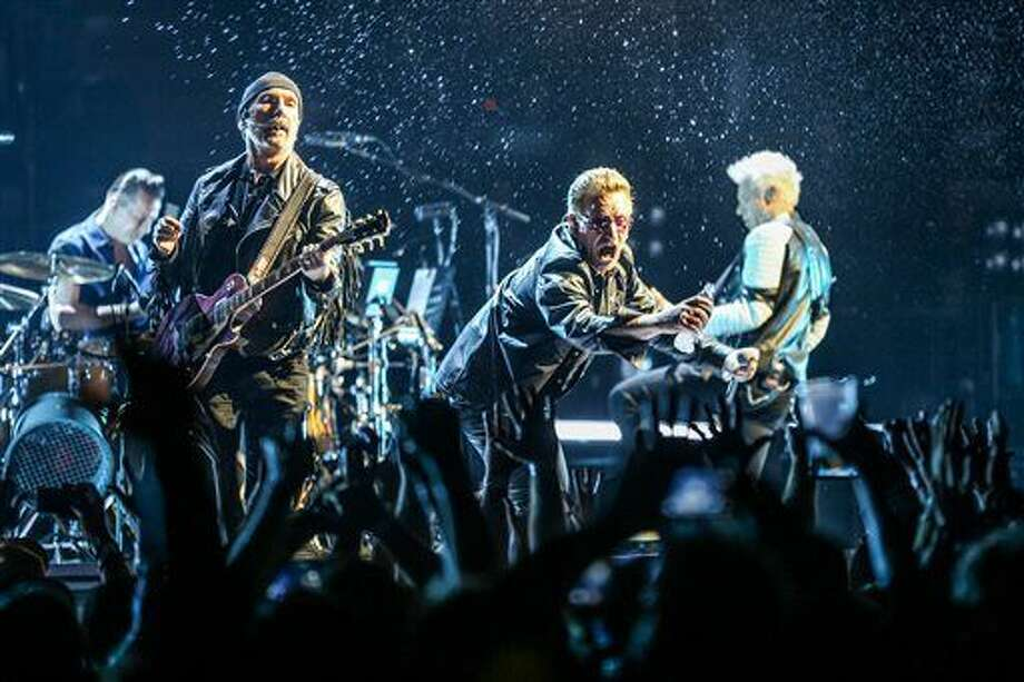 FILE - In this May 26, 2015 file photo, Larry Mullen Jr., from left, The Edge, Bono and Adam Clayton of U2 perform at the Innocence + Experience Tour at The Forum in Inglewood, Calif. (Photo by Rich Fury/Invision/AP, File) Photo: Rich Fury