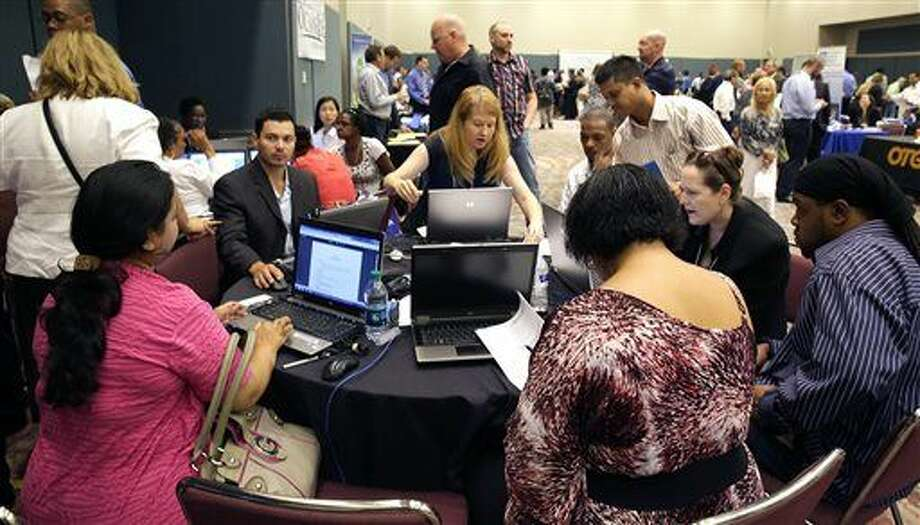 FILE - In this Sept. 10, 2014 file photo, job seekers create resumes at the NJ Department of Labor's resume clinic in the Atlantic City Convention Center in Atlantic City, N.J. Ten U.S. states still have not regained all the jobs they lost in the Great Recession, even after six and a half years of recovery, while many more have seen only modest gains. New Jersey has nearly 1 percent fewer jobs than it did at the end of 2007, and Missouri is just below its pre-recession level. (Michael Ein/The Press of Atlantic City via AP) MANDATORY CREDIT Photo: Michael Ein