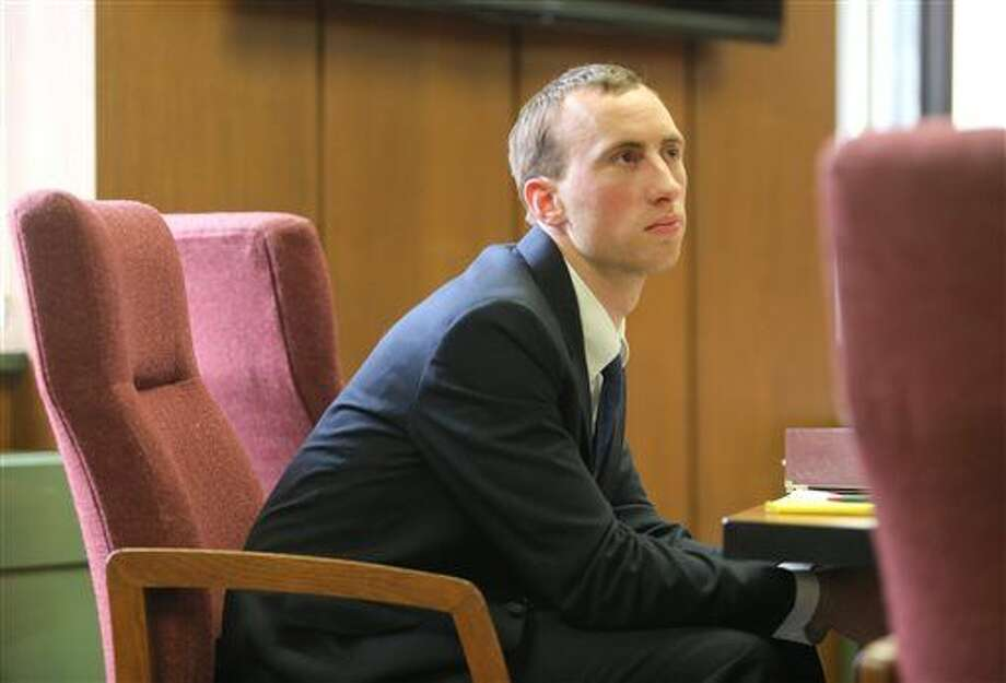 Aaron Pelletier sits in court during his trial on March 22, 2016 in Kalamazoo, Mich. A jury convicted Pelletier of third-degree fleeing and eluding and felony firearm possession on Thursday, March 24. He was acquitted of carrying a concealed weapon. (Mark Bugnaski/Kalamazoo Gazette-MLive Media Group via AP) LOCAL TELEVISION OUT; LOCAL RADIO OUT; MANDATORY CREDIT Photo: Mark Bugnaski