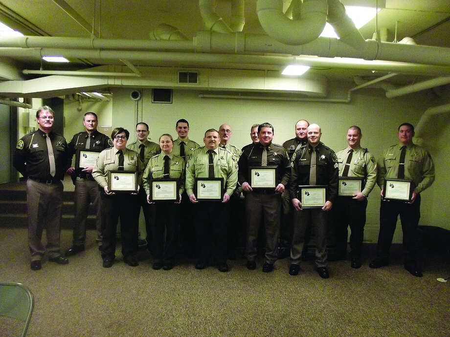 Deputies recognized at the sheriff's office annual meeting are, front row, from left: Duane Miller, Jordan Gunsell, Charles Stevens, Dan Maxwell, Ryan Swartz, Steve Bismack, Troy Helewski and Josh Loss; and, back row, from left: Katie Carter, Stephanie Voss, Steve Bischer, Daryl Ford and Ryan Neumann. (Submitted Photo)
