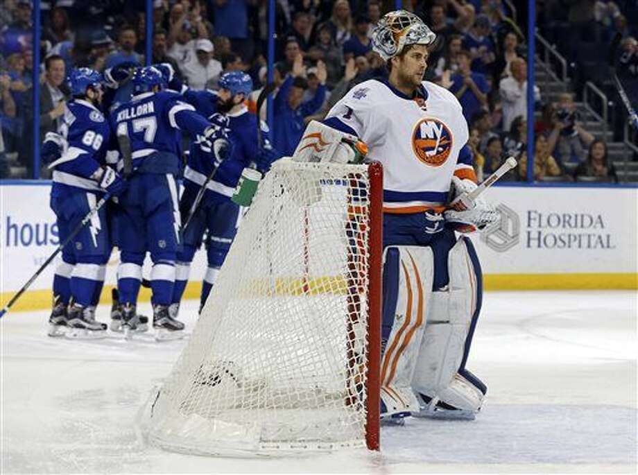 New York Islanders goalie Thomas Greiss, of Germany, reacts as Tampa Bay Lightning players celebrate a goal during the second period of an NHL hockey game Friday, March 25, 2016, in Tampa, Fla. (AP Photo/Mike Carlson) Photo: Mike Carlson