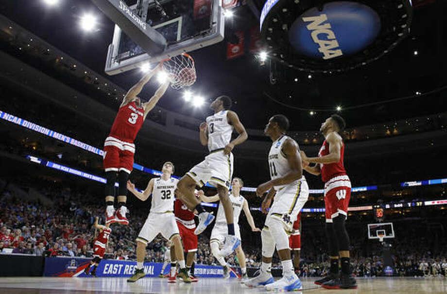 Wisconsin's Zak Showalter (3) dunks as Notre Dame's V.J. Beachem (3) and Steve Vasturia (32) watch during the second half of an NCAA college basketball game in the regional semifinals of the men's NCAA Tournament, Friday, March 25, 2016, in Philadelphia. (AP Photo/Matt Rourke) Photo: Matt Rourke