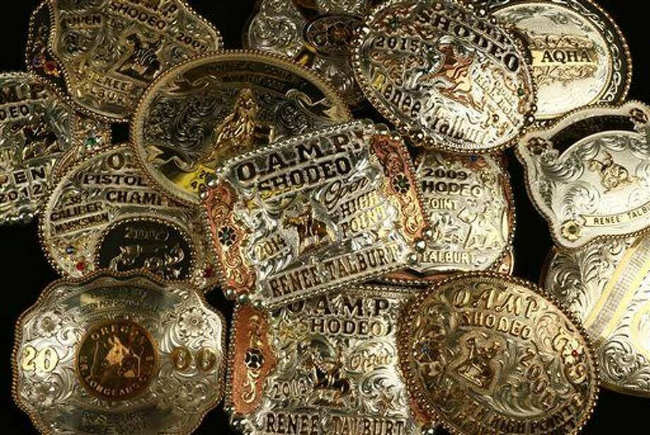 ADVANCE FOR USE SATURDAY, MARCH 26 - In this photo taken March 8, 2016, a collection of award buckles earned by Renee Talburt of Roseburg, Ore., are displayed. (Michael Sullivan/The News-Review via AP) MANDATORY CREDIT Photo: Michael Sullivan