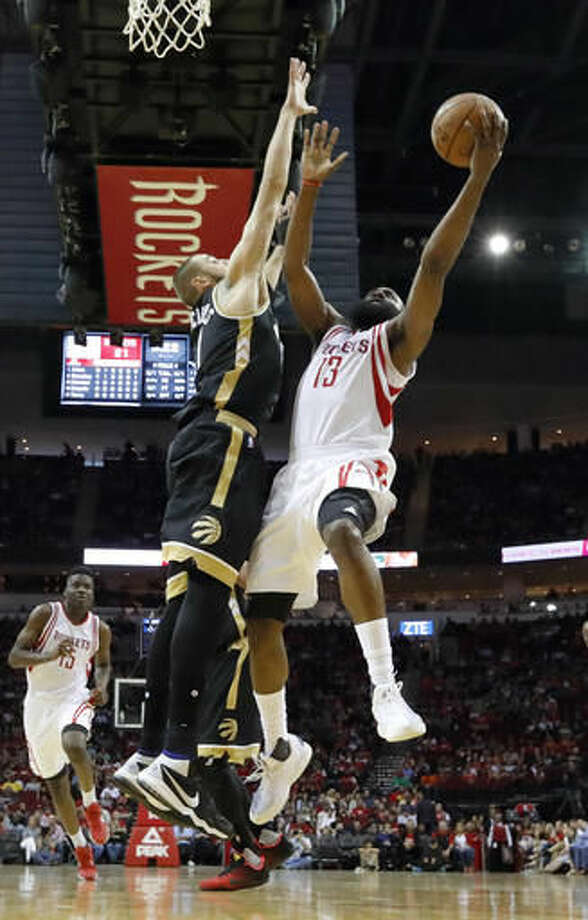 Houston Rockets' James Harden (13) goes up for a shot as Toronto Raptors' Jonas Valanciunas defends during the first quarter of an NBA basketball game Friday, March 25, 2016, in Houston. (AP Photo/David J. Phillip) Photo: David J. Phillip