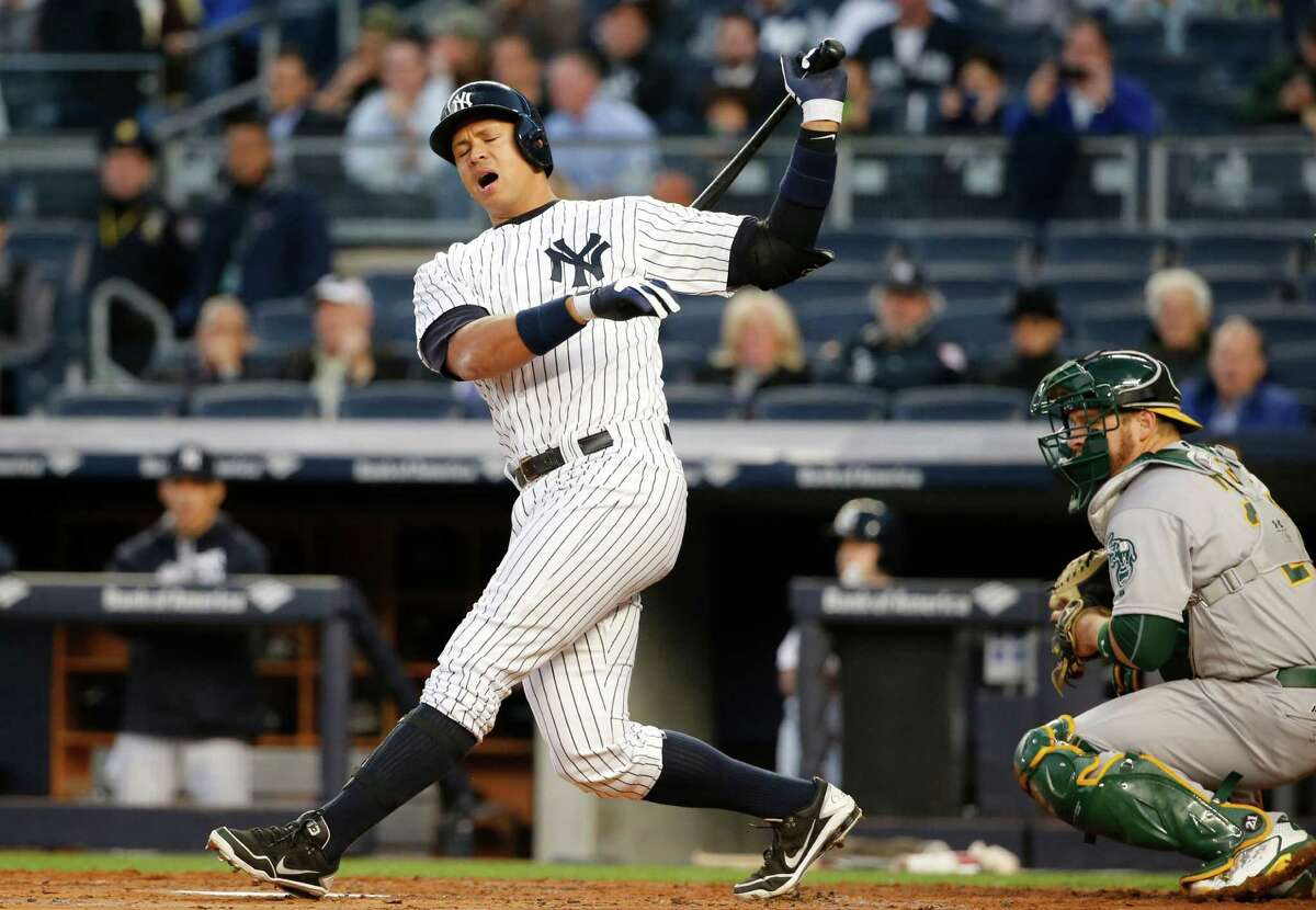 New York Yankees designated hitter Alex Rodriguez reacts in a first-inning at-bat against the Oakland Athletics in which he struck out with the bases loaded in a baseball game in New York, Wednesday, April 20, 2016. (AP Photo/Kathy Willens) ORG XMIT: NYY101