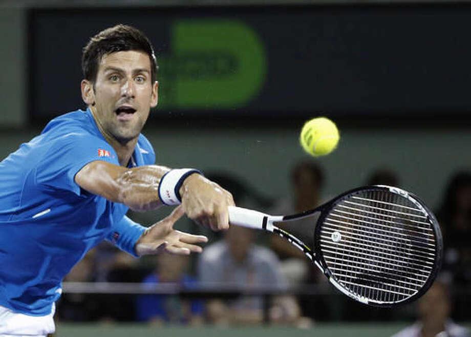 Novak Djokovic of Serbia, attempts to return a shot from Kyle Edmund of Britain, during a match at the Miami Open tennis tournament, in Key Biscayne, Fla., Friday, March 25, 2016. Djokovic defeated Edmund 6-3, 6-3. (AP Photo/Wilfredo Lee) Photo: Wilfredo Lee