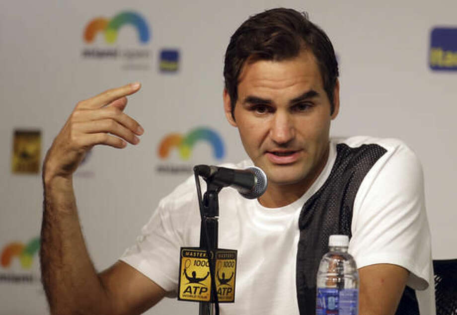 Roger Federer, of Switzerland, responds to a question during a news conference at the Miami Open tennis tournament, Thursday, March 24, 2016, in Key Biscayne, Fla. This is Federer's first tournament since recovering from knee surgery. (AP Photo/Lynne Sladky) Photo: Lynne Sladky