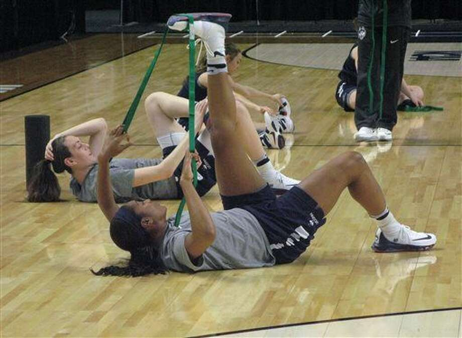 UConn's Morgan Tuck, foreground, and Breanna Stewart stretch during practice for Saturday's NCAA women's college regional semifinal game with Mississippi State at the Webster Bank Arena in Bridgeport, Conn., Friday, March 25, 2016. The Huskies are making their 23rd straight appearance in the Sweet 16 (AP Photo/Pat Eaton-Robb) Photo: Pat Eaton-Robb