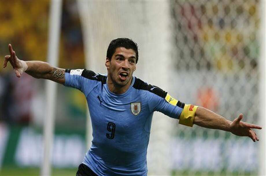 Uruguay's Luis Suarez celebrates after scoring against Brazil during a 2018 World Cup qualifying soccer match at the Pernambuco Arena, in Recife, Brazil, Friday, March 25, 2016. (AP Photo/Leo Correa) Photo: Leo Correa