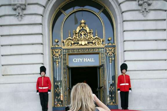 Caroline Altman photographs the front of City Hall before SF Opera's Nod to Mod Ball in San Francisco, Calif., on Wednesday, April 20, 2016.