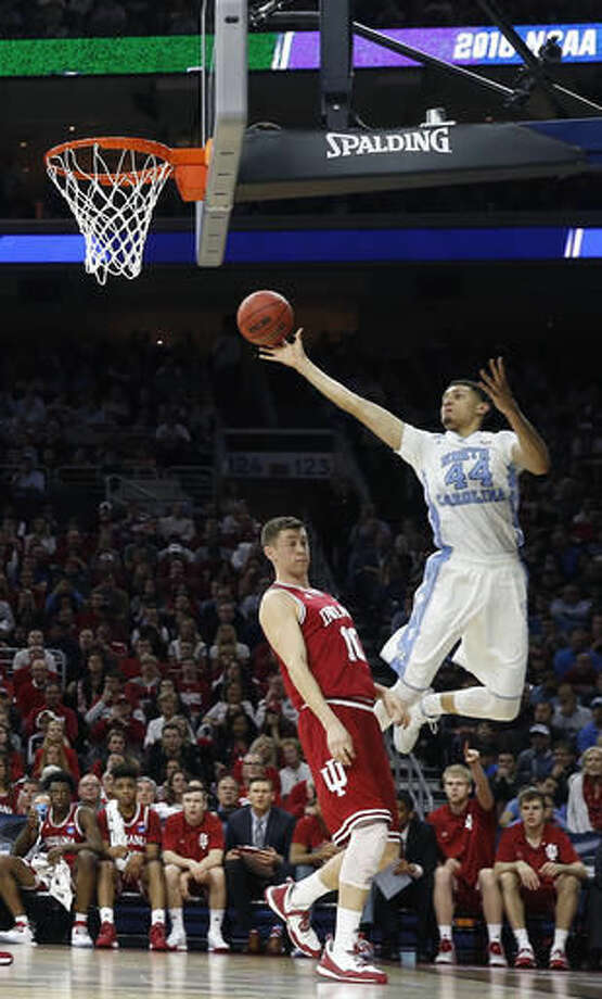 North Carolina's Justin Jackson shoots as Indiana's Ryan Burton defends during the first half of an NCAA college basketball game in the regional semifinals of the men's NCAA Tournament, Friday, March 25, 2016, in Philadelphia. (AP Photo/Matt Rourke) Photo: Matt Rourke