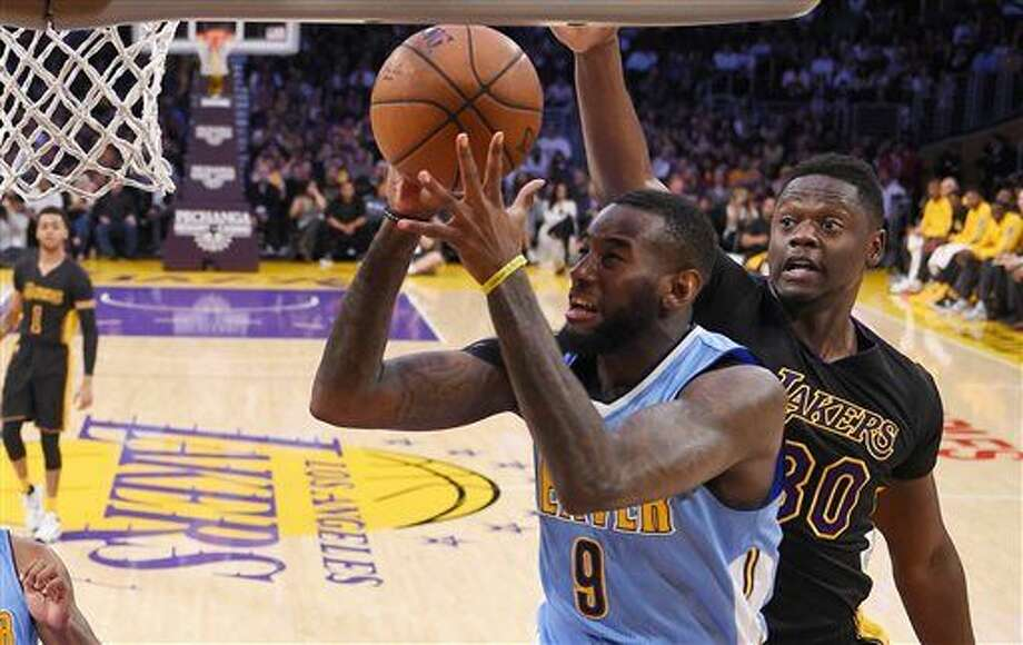 Denver Nuggets guard JaKarr Sampson shoots as Los Angeles Lakers forward Julius Randle defends during the first half of an NBA basketball game, Friday, March 25, 2016, in Los Angeles. AP Photo/Mark J. Terrill) Photo: Mark J. Terrill