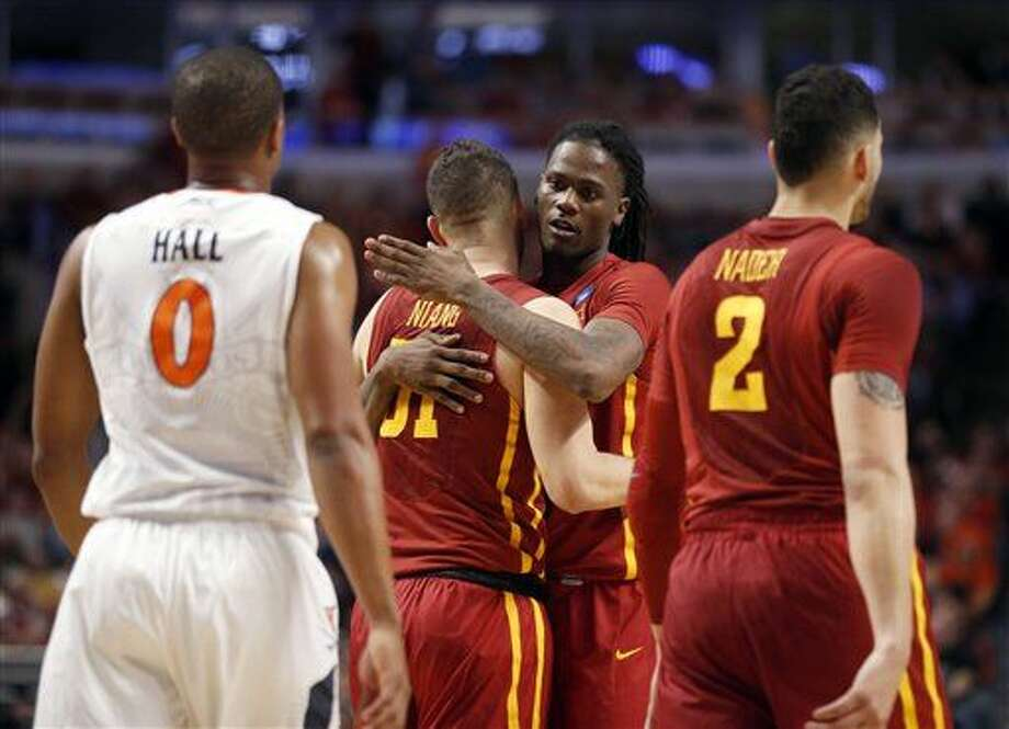 Iowa State's Jameel McKay, second from right, hugs Georges Niang (31) in the final seconds of a college basketball game in the regional semifinals of the NCAA Tournament, Friday, March 25, 2016, in Chicago. Virginia won 84-71. (AP Photo/Charles Rex Arbogast) Photo: Charles Rex Arbogast