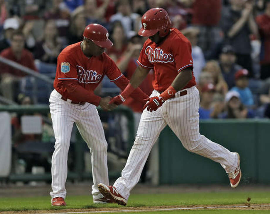 Philadelphia Phillies' Maikel Franco, right, shakes hands with third base coach Juan Samuel after hitting a home run off Toronto Blue Jays starting pitcher Marco Estrada during the third inning of a spring training baseball game Friday, March 25, 2016, in Clearwater, Fla. (AP Photo/Chris O'Meara) Photo: Chris O'Meara