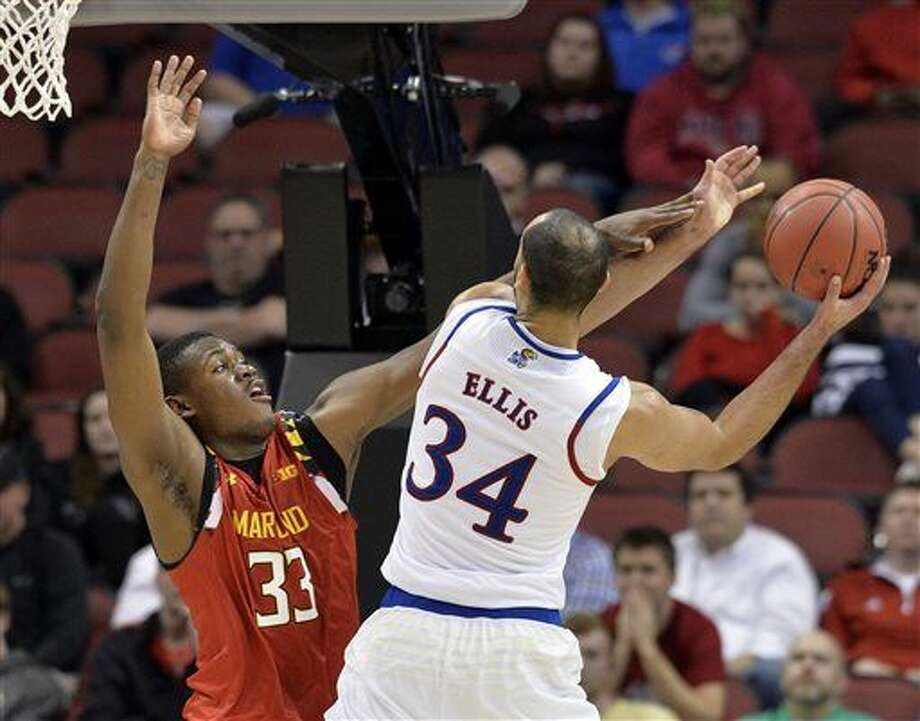 Maryland center Diamond Stone (33) attempts to block the shot of Kansas forward Perry Ellis (34) during the second half of an NCAA college basketball game in the regional semifinals of the men's NCAA Tournament, in Louisville, Ky., Thursday, March 24, 2016. Kansas won 79-63, (AP Photo/Timothy D. Easley) Photo: Timothy D. Easley